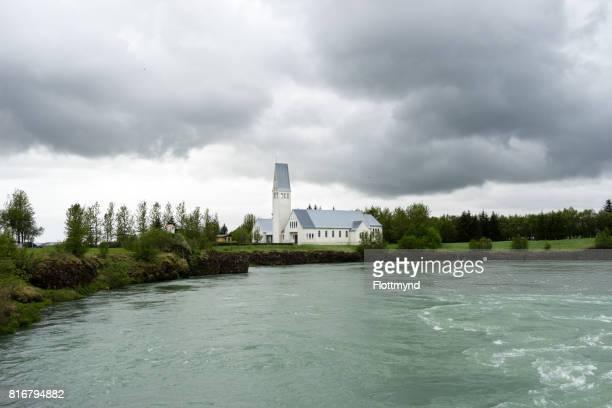 Selfosskirkja next to the Olfusa river in Selfoss, Iceland