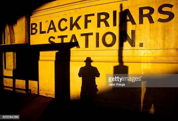 Self-portrait at London's Blackfriars rail station at sunset