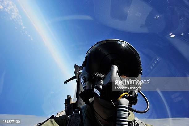 Self-portrait of a pilot in the cockpit of his aircraft during flight.