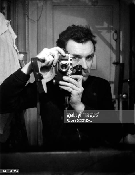 Selfportrait of Robert Doisneau in his laboratory France in 1954
