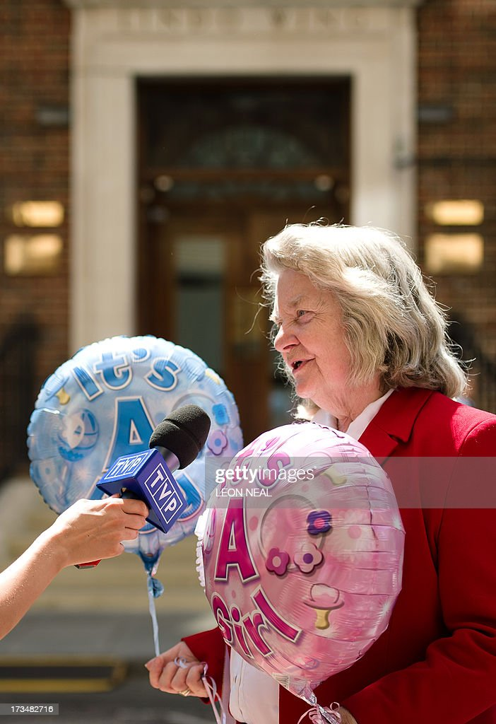 Self-proclaimed 'Loyalest Royalist' Margaret Tyler holds both 'It's a Girl!' and 'It's a Boy!' balloons as she gets interviewed outside the Lindo Wing of Saint Mary's Hospital in London, on July 15, 2013, where Prince William and his wife Catherine's baby will be born. The hospital is ready, the Wikipedia page and Twitter accounts are up and Britain's famously creative press are running out of ideas. But Mondat arrived with no sign of the royal baby. AFP PHOTO / LEON NEAL