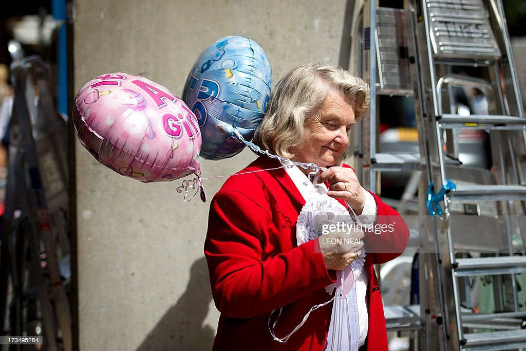 Self-proclaimed 'Loyalest Royalist' Margaret Tyler stands with 'It's a Boy!' and 'It's a Girl' balloons outside the Lindo Wing of Saint Mary's Hospital in London, on July 15, 2013, where Prince William and his wife Catherine's baby will be born. The hospital is ready, the Wikipedia page and Twitter accounts are up and Britain's famously creative press are running out of ideas. But Sunday arrived with no sign of the royal baby.