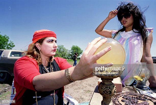 WACO TX APRIL 10 Selfproclaimed psychic Zena Marrs of Waco uses her crystal ball to look into the future of Margie Aleman 10 April 1993 at her...