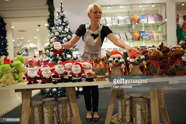 Selfridges employee Nicola Storey poses with toys and decorations displayed in the Christmas shop at Selfridges department store on July 28 2011 in...