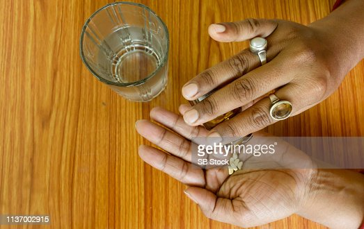 Self-treatment at home as per prescribed by doctor. : Stock Photo