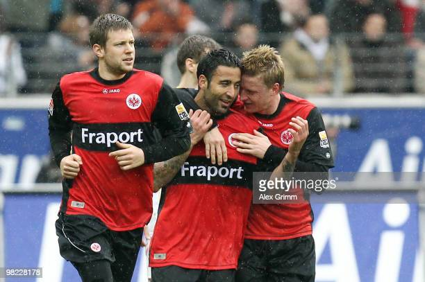 Selim Teber of Frankfurt celebrates his team's first goal with team mates Marco Russ and Patrick Ochs during the Bundesliga match between Eintracht...