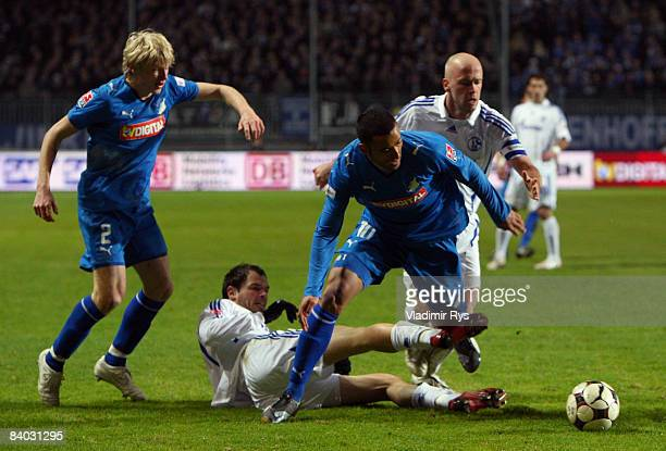 Selim Teber of Hoffenheim gets attacked by Heiko Westermann of Schalke during the Bundesliga match between TSG 1899 Hoffenheim and FC Schalke 04 at...