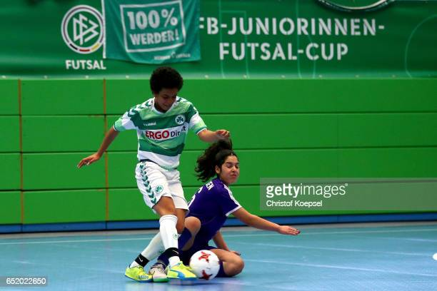 Selin Mercan of SGS Essen challenchallenges Patricia Gahm of SpVgg Greuther Fuerth during the C Junior Girl's German Futsal Championship premilary...