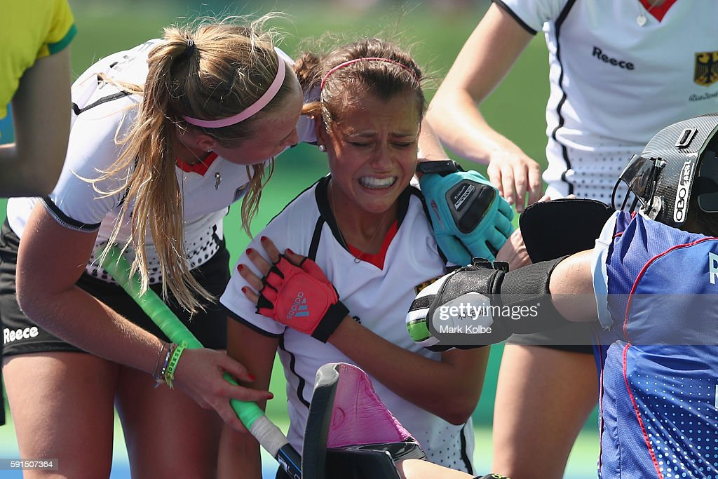 Selin Oruz of Germany holds her shoulder after being struck during the womens semifinal match between the Netherlands and Germany on Day 12 of the...