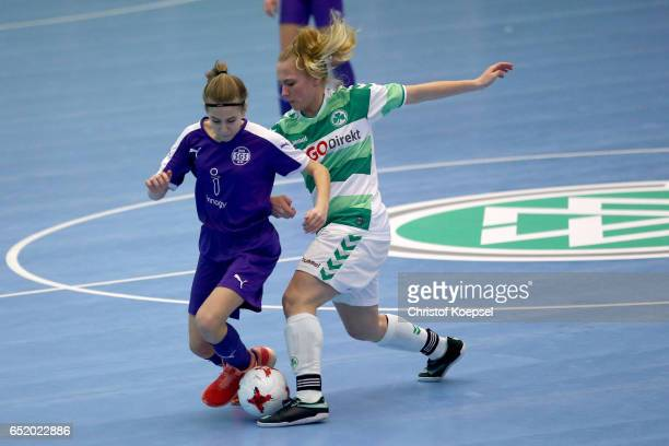 Selina Fink of SpVgg Greuther Fuerth challenges Paula Druschke of SGS Essen during the C Junior Girl's German Futsal Championship premilary match...