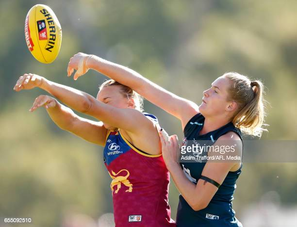 Selina Goodman of the Lions and Breann Moody of the Blues compete in a ruck contest during the 2017 AFLW Round 07 match between the Carlton Blues and...