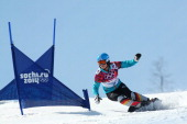 Selina Joerg of Germany competes in the Snowboard Ladies' Parallel Slalom 1/8 Finals on day 15 of the 2014 Winter Olympics at Rosa Khutor Extreme...