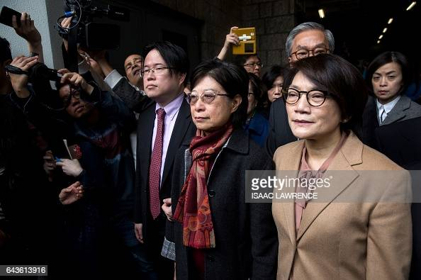 Selina Tsang accompanied by her son Simon Tsang Hingyin and sisterinlaw Katherine Tsang Kingsuen leaves the High Court after her husband former Hong...