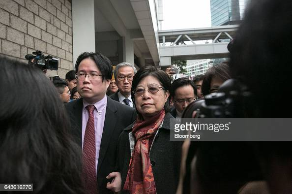 Selina Tsang wife of Hong Kong's former chief executive Donald Tsang center is accompanied by her son Simon Tsang Hingyin center left and her brother...