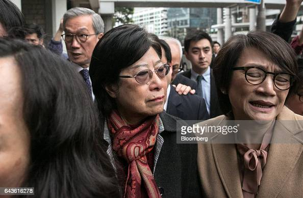 Selina Tsang wife of Hong Kong's former chief executive Donald Tsang center stands outside the High Court in Hong Kong China on Wednesday Feb 22 2017...