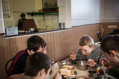 Selischev Juriy a 13yearold orphan who's mother was killed during fighting between the Ukrainian Army and proRussian rebels eats lunch at Torez...