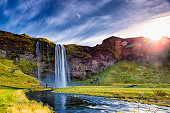 Seljalandsfoss Waterfall against the sunlight,  South Iceland