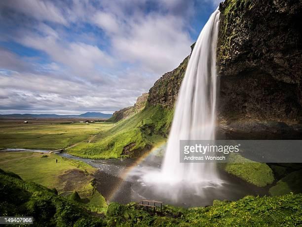 Seljalandsfoss waterfall with rainbow