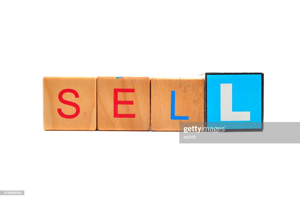 Sell - text in wooden cubes, business shopping concept words : Stock Photo