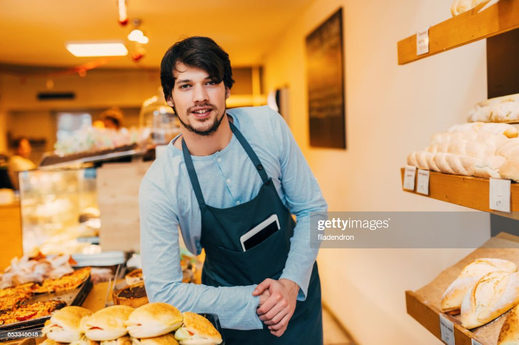Seller at a bakery : Bildbanksbilder