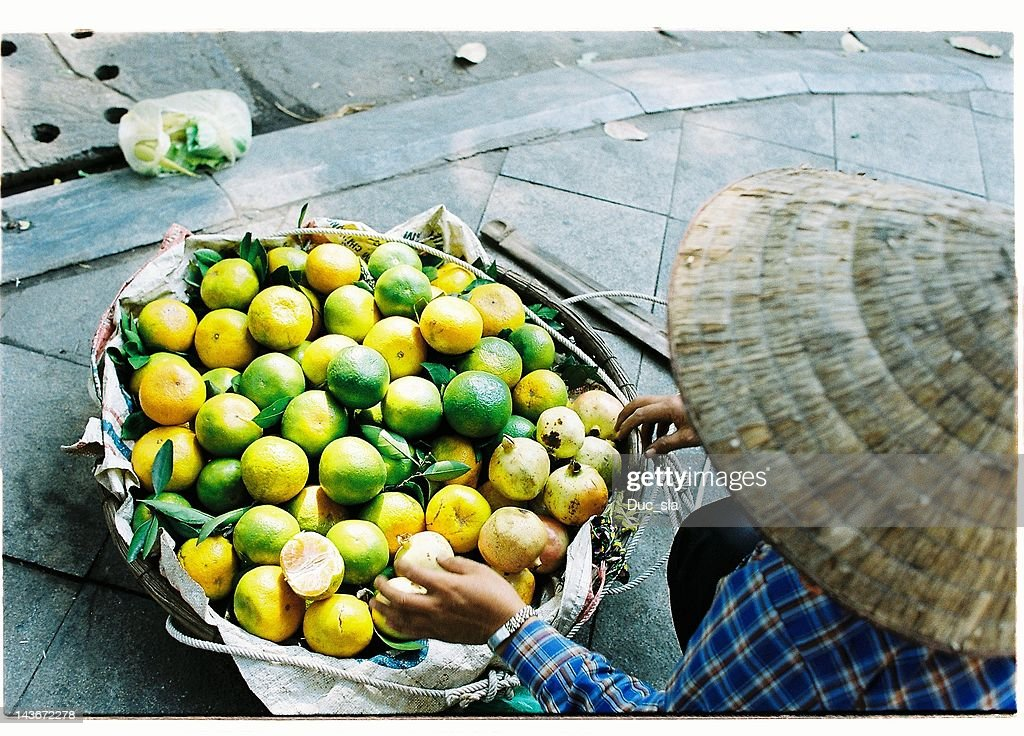 Stock photo seller selling oranges on street