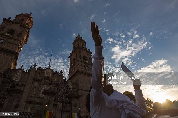 A seller with products of Pope Francis shouts at the downtown of Morelia on February 15 2016 in Morelia Mexico On Tuesday Pope Francis will travel to...