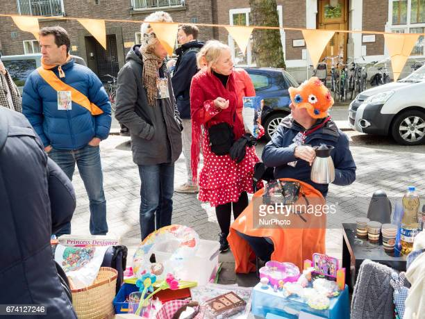 Sellers and buyers attend a vrijmarkt in Amsterdam The Netherlands 27 April 2017 on the traditional King's Day the celebration of the birthday of...
