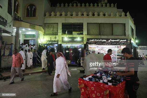 Sellers exit a mosque after a prayer to go back to open their shops at the popular market of Qabil street in the heart of Jeddah historic center on...