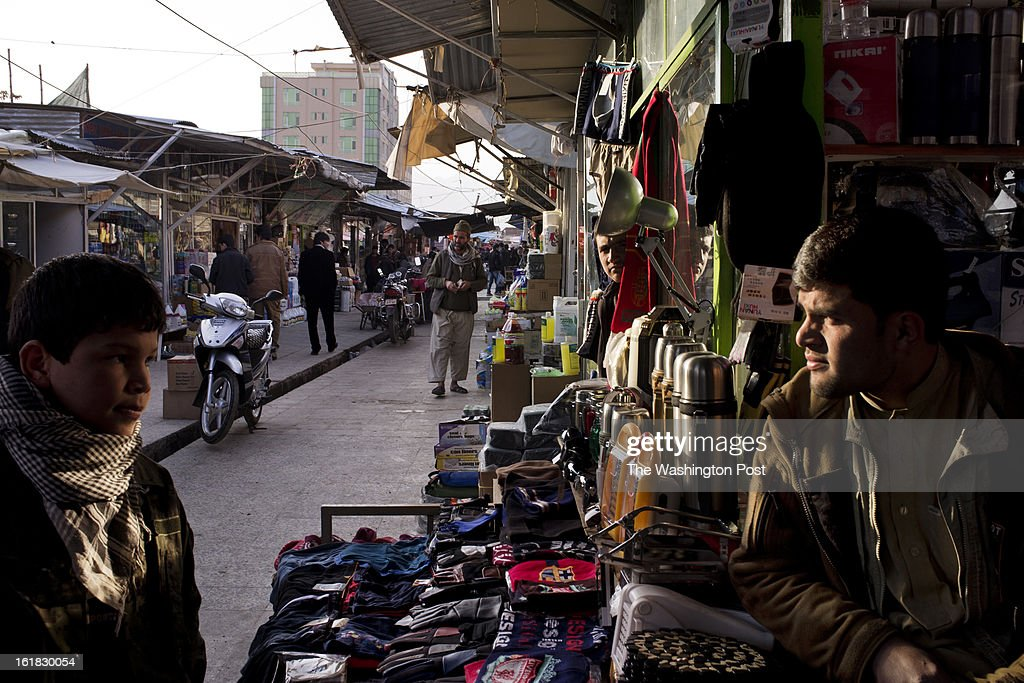 Sellers sits outside their shop in Bush Market. If a case of soap is pilfered from a U.S. military base here or pinched from a NATO shipping container, it will probably, sooner or later, end up for sale in the Bush Market, a sort of thieves' outlet mall in central Kabul. Named after the former U.S. president who launched the war in Afghanistan, the bazaar has flourished for more than eight years, thanks to the long presence of foreign troops that provided war booty aplenty. But in the Obama era, with its steady withdrawal of U.S. forces, the good times are ending.