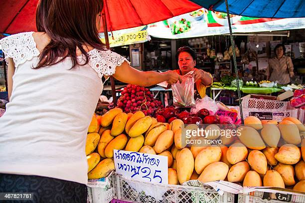 Selling fresh mango and fruits at the market