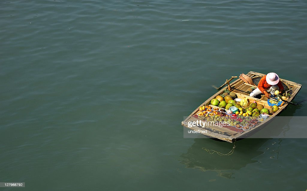 Selling fruits in boat : Stock Photo