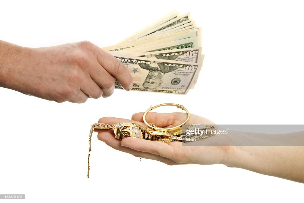 Selling gold for cash : Stock Photo