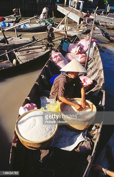 Selling rice from open boat, Cai Rang floating market, Mekong Delta.