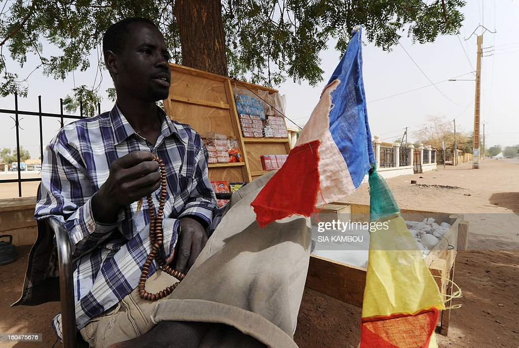 A sellor with French and Malian flags on his stall sells his wares on the side of the road on February 1, 2013 in Gao. France's president Francois Hollande prepared to visit Mali as French-led troops worked today to secure the last Islamist stronghold in the north after a lightning offensive against the extremists.