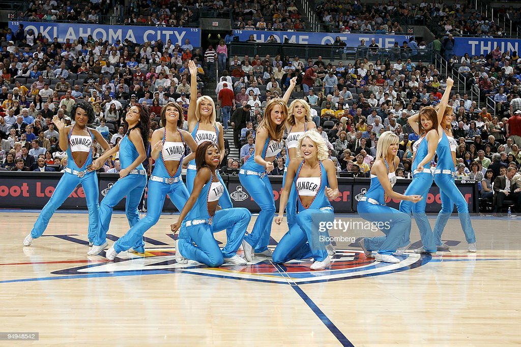 A sellout crowd of 19,136 watches a performance by the Oklahoma City Thunder Girls during a National Basketball Association (NBA) game against the Los Angeles Lakers at the Ford Center in Oklahoma City, Oklahoma, U.S., on Tuesday, March 24, 2009. Nearly three decades after an energy bust that forced 122 banks to close statewide, Oklahoma City is in the fifth year of an economic expansion that's produce the lowest jobless rate for a major metro U.S. area. Oklahoma City demonstrated it could support a NBA team, encouraging the Seattle Supersonics to move permanently and become the Thunder, which now draw crowds as large as the Boston Celtics.