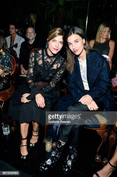 Selma Blair and Rainey Qualley at HM x ERDEM Runway Show Party at The Ebell Club of Los Angeles on October 18 2017 in Los Angeles California