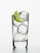 Seltzer water with lime wedge