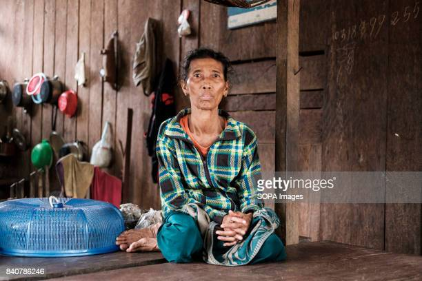 Sem Sokha owns a business by the river in Krabei Chrun village She believes the waters will rise and she'll be forced to close down and loose her...
