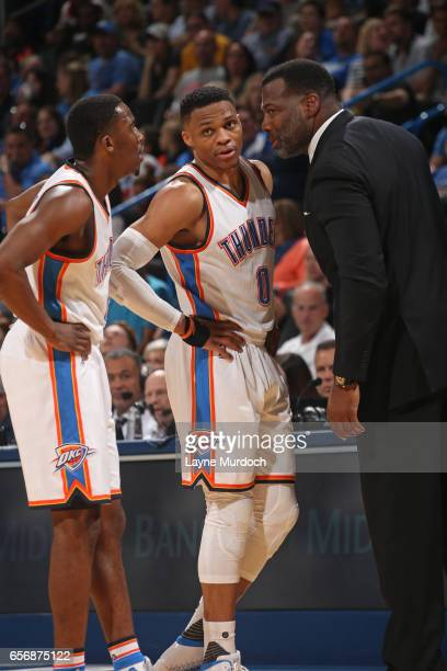 Semaj Christon Mark Bryant and Russell Westbrook of the Oklahoma City Thunder talk during the game against the Philadelphia 76ers on March 22 2017 at...