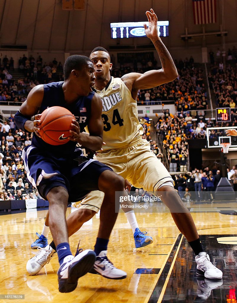 Semaj Christon #0 of the Xavier Musketeers dribbles to the hoop as Jacob Lawson #34 of the Purdue Boilermakers defends at Mackey Arena on December 1, 2012 in West Lafayette, Indiana. Xavier defeated Purdue 63-57.