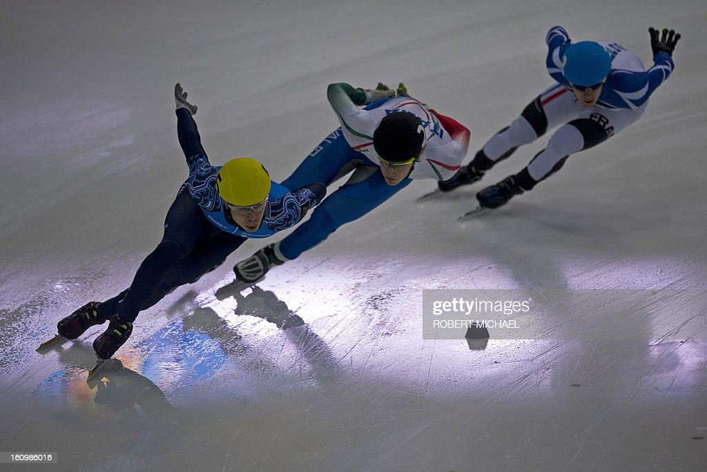 Semen Elistratov of Russia competes in front of Tommaso Dotti of Italy and Vincent Jeanne of France in the men's 1500m preliminaries of the ISU World Cup short track speed skating event in Dresden, eastern Germany, on February 8, 2013.