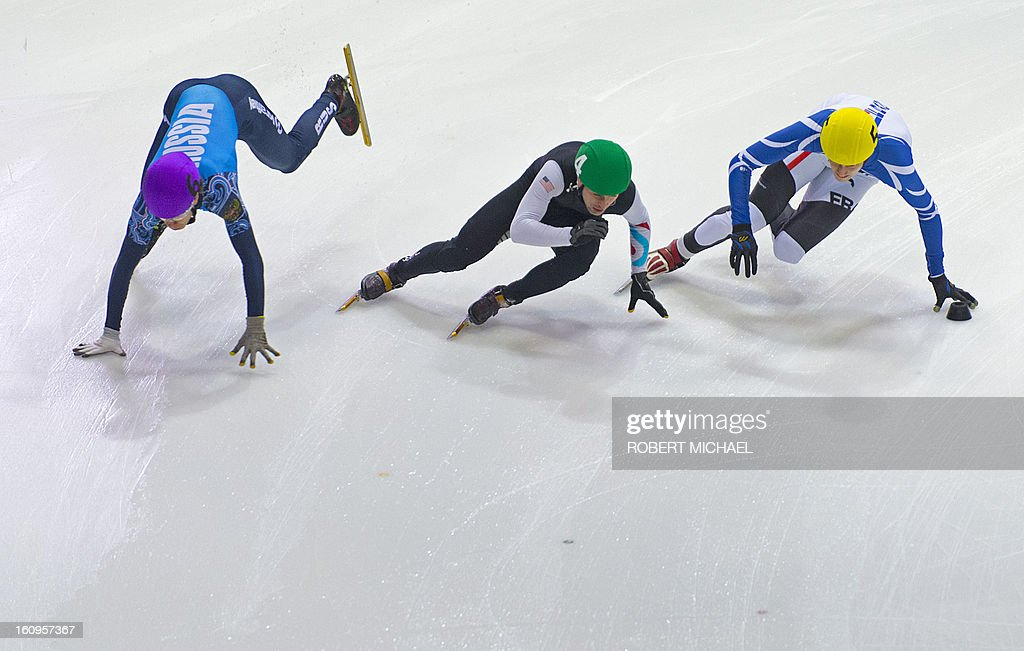 Semen Elistratov (L) of Russia crahs next to Jeff Simon (C) of US and Sebastian Lepap of France at the men's 1500m heat race of the ISU World Cup short track speed skating event in Dresden, eastern Germany, on February 8, 2013. .