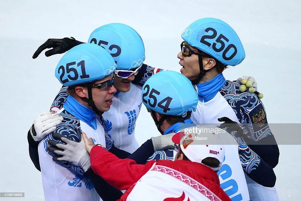 Semen Elistratov Vladimir Grigorev Ruslan Zakharov and Victor An of Russia celebrate winning the gold medal in the Short Track Men's 5000m Relay on...