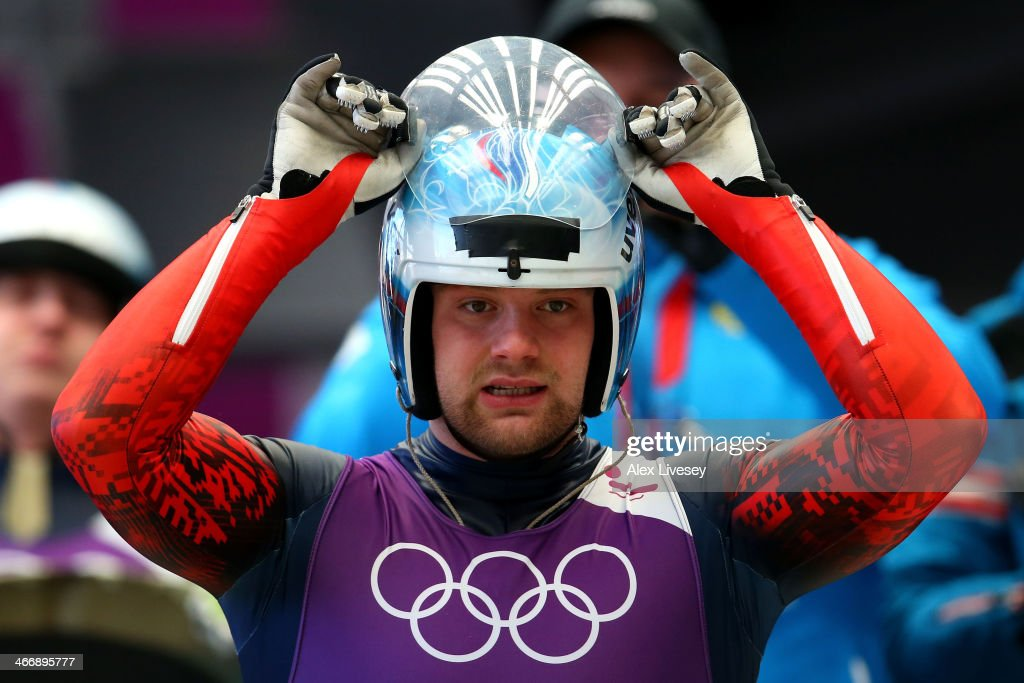 Semen Pavlichenko of Russia adjusts his helmet during a men's luge training session ahead of the Sochi 2014 Winter Olympics at the Sanki Sliding Center on February 5, 2014 in Sochi, Russia.