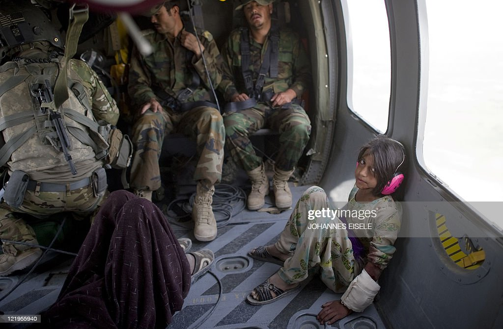 Semena a tenyear old wounded Afghan girl sits in a Medevac helicopter of US army 159th Brigade Task Force Thunder airlifted to Kandahar hospital on...
