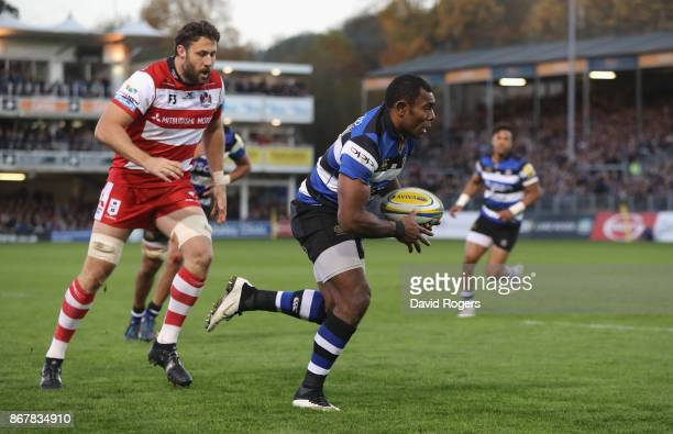 Semesa Rokoduguni of Bath breaks through to score a late tryk during the Aviva Premiership match between Bath Rugby and Gloucester Rugby at the...