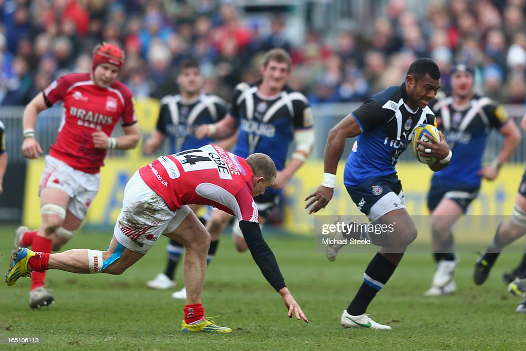 Semesa Rokoduguni (R) of Bath bursts clear of Phil Mackenzie (L) of London Welsh to score his sides third try during the Aviva Premiership match between Bath and London Welsh at the Recreation Ground on March 30, 2013 in Bath, England.