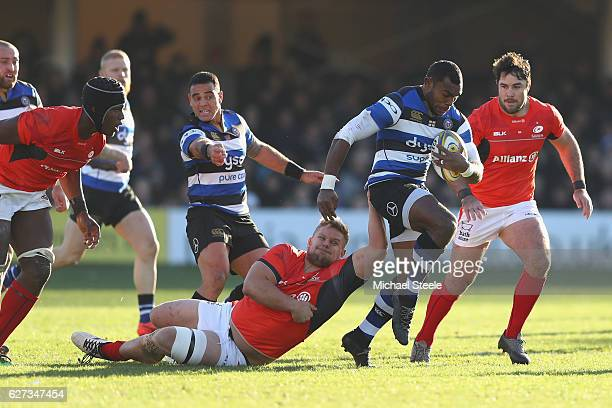 Semesa Rokoduguni of Bath bursts past the challenge of Vincent Koch of Saracens during the Aviva Premiership match between Bath Rugby and Saracens at...