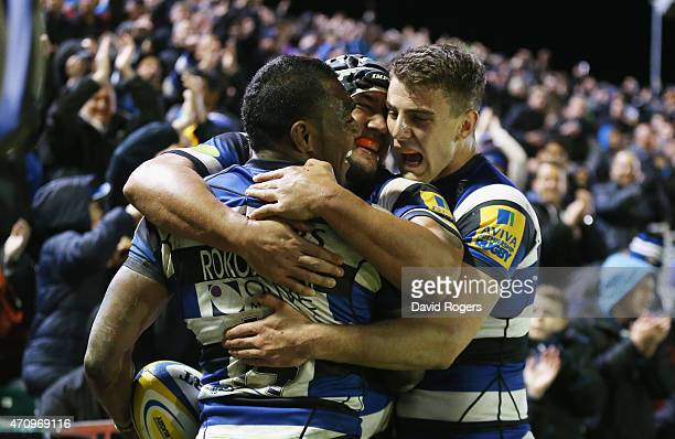 Semesa Rokoduguni of Bath celebrates with team mates Leroy Houston and Ollie Devoto after scoring their fifth try during the Aviva Premiership match...