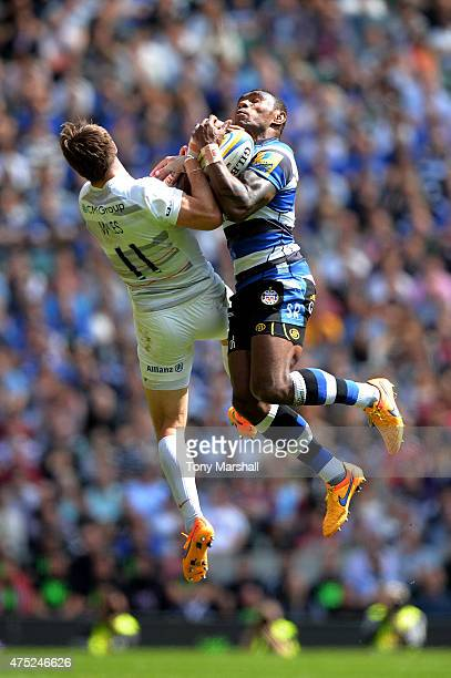 Semesa Rokoduguni of Bath claims a high ball under pressure from Chris Wyles of Saracens during the Aviva Premiership Final between Bath Rugby and...